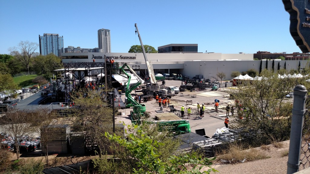A work crew setting up a stage
