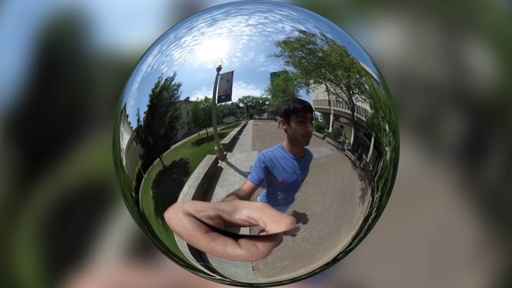 A 360 degree panoramic image of a person walking on a college campus