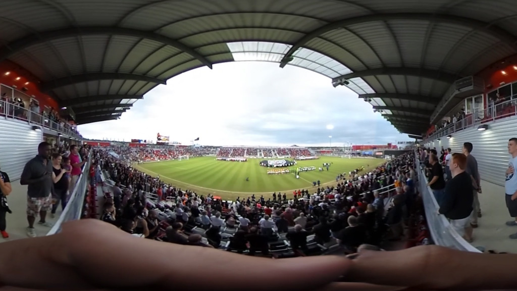 A panoramic picture of a soccer game